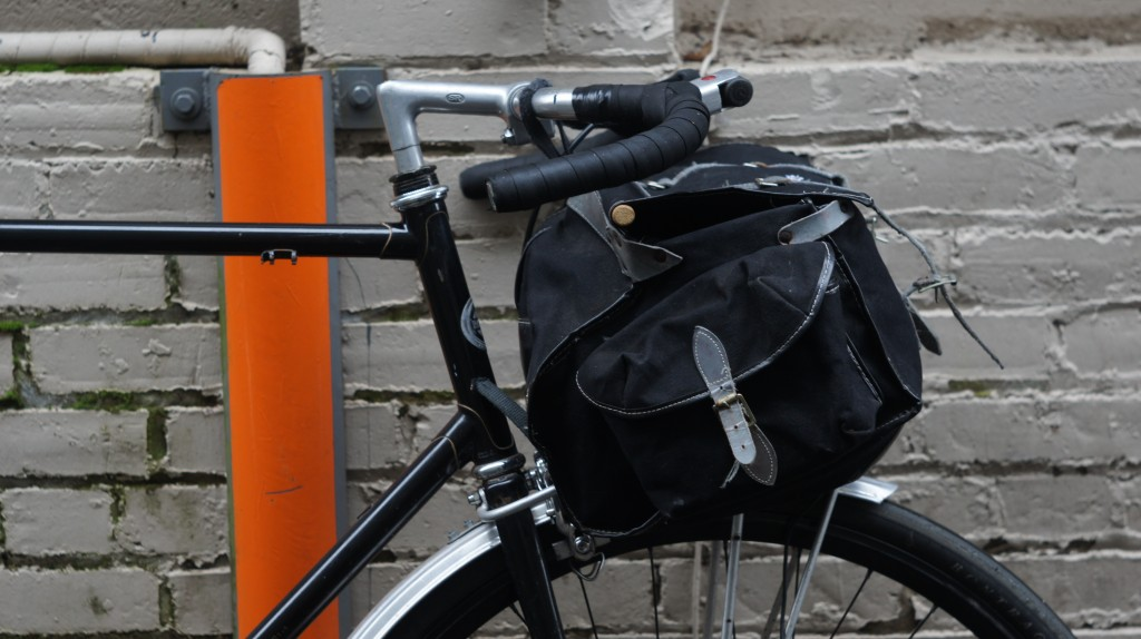 low trail ross with large front bag and moustache bars